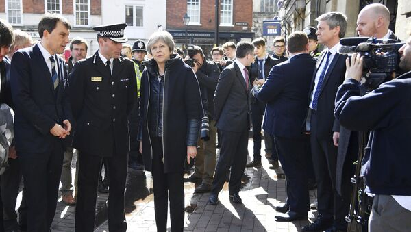 Britain's Prime Minister Theresa May, centre, is briefed by members of the police as she views the area where former Russian double agent Sergei Skripal and his daughter were found critically ill, in Salisbury, England, Thursday, March 15, 2018 - Sputnik International