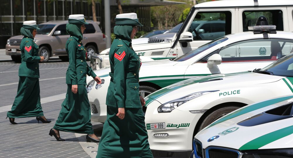 In this Thursday May 19, 2016 photo, Dubai police women walk towards their luxury cars during a demonstration in Dubai, United Arab Emirates