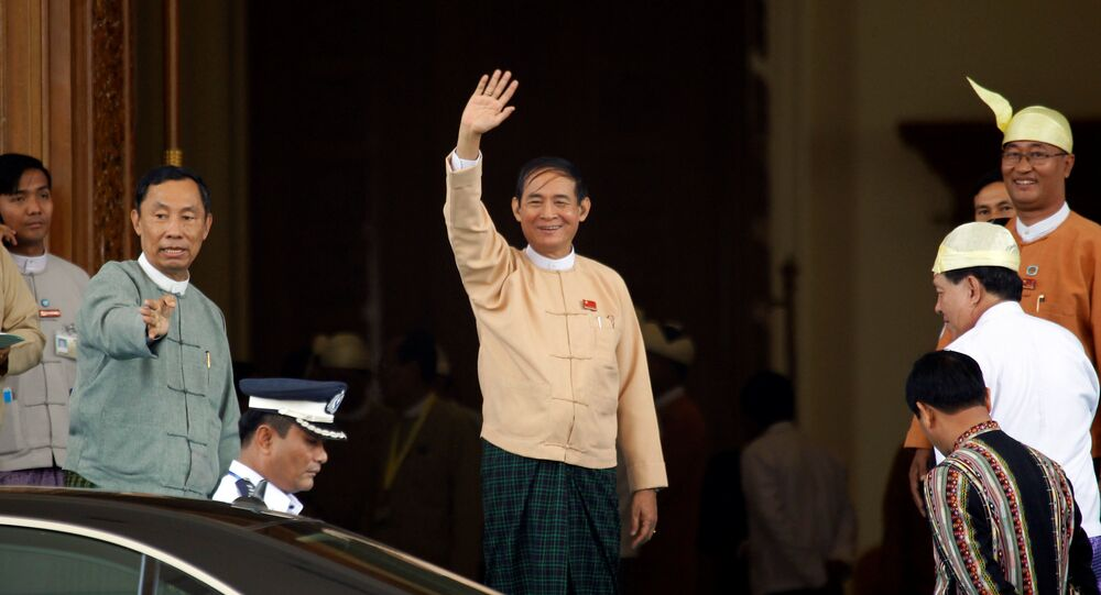 Win Myint waves after he was elected as Myanmar's President in Parliament at Naypyitaw, Myanmar March 28, 2018