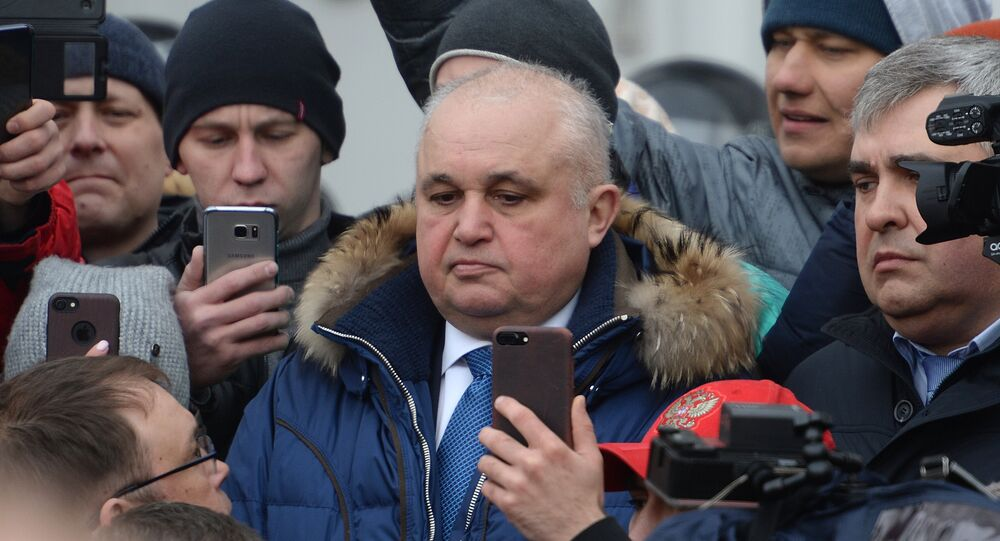 Deputy Governor of the Kemerovo Region Sergei Tsivilev, center, talks to the participants in a spontaneous rally in memory of those killed in a fire at the Zimnyaya Vishnya shopping mall, in front of the Kemerovo administration on Sovetov Square