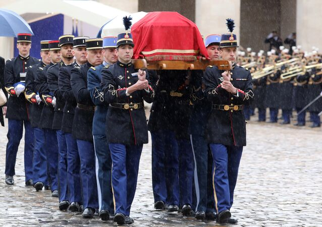Republican Guards, Gemdarmes and Cadets from the joint-army military school (Ecole Militaire Interarmes, EMIA) carry the coffin of Lieutenant-Colonel Arnaud Beltrame during a national ceremony at the Hotel des Invalides in Paris, France, March 28, 2018