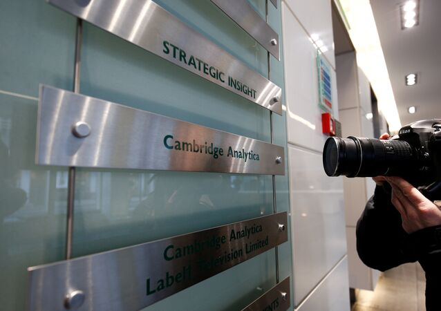 A photographer takes a photograph of the nameplate of political consultancy, Cambridge Analytica, in central London, Britain March 21, 2018