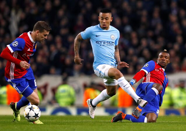 Champions League Round of 16 Second Leg - Manchester City vs FC Basel - Etihad Stadium, Manchester, Britain - March 7, 2018 Manchester City's Gabriel Jesus in action with Basel's Serey Die and Fabian Frei
