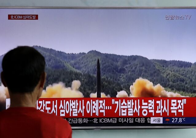 A man watches a TV news program showing a file image of a missile being test-launched by North Korea, at Seoul Railway Station in Seoul, South Korea. (File)