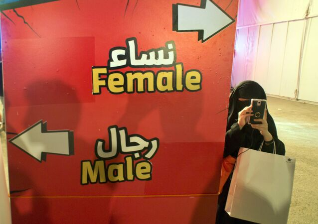 Visitor takes pictures at the entrance of the female section, during the Saudi Comic Con (SCC) which is the first event of its kind to be held in Jiddah, Saudi Arabia. (File)