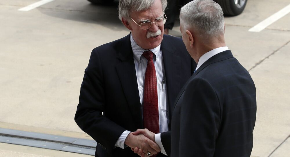President Donald Trump's pick for national security adviser John Bolton, left, shakes hands with Defense Secretary Jim Mattis, as Bolton arrives at the Pentagon, Thursday, March 29, 2018, in Washington.