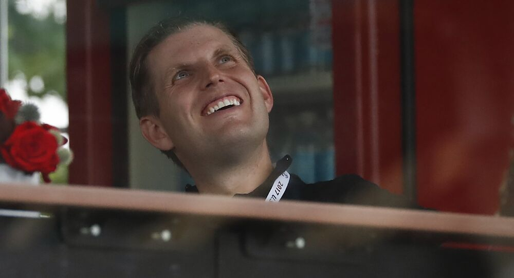 Eric Trump, the son of President Donald Trump, looks out from the presidential viewing stand, Friday, July 14, 2017, at Trump National Golf Club in Bedminster, N.J.
