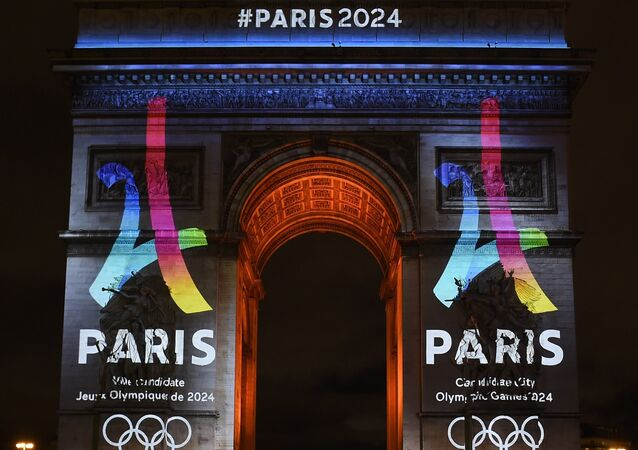 The campaign's official logo of the Paris bid to host the 2024 Olympic Games is seen on the Arc de Triomphe in Paris on February 9, 2016.