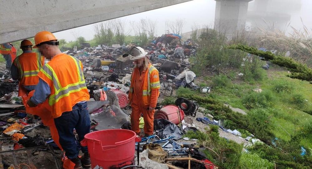 An inmate work crew cleans up 1,300 pounds of trash from a homeless encampment in Eureka, California.