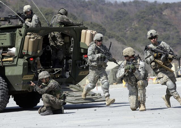 U.S. Army soldiers from the 25th Infantry Division's 2nd Stryker Brigade Combat Team and South Korean soldiers take their position during a demonstration of the combined arms live-fire exercise as a part of the annual joint military exercise Foal Eagle between South Korea and the United States at the Rodriquez Multi-Purpose Range Complex in Pocheon, north of Seoul, South Korea. (File)