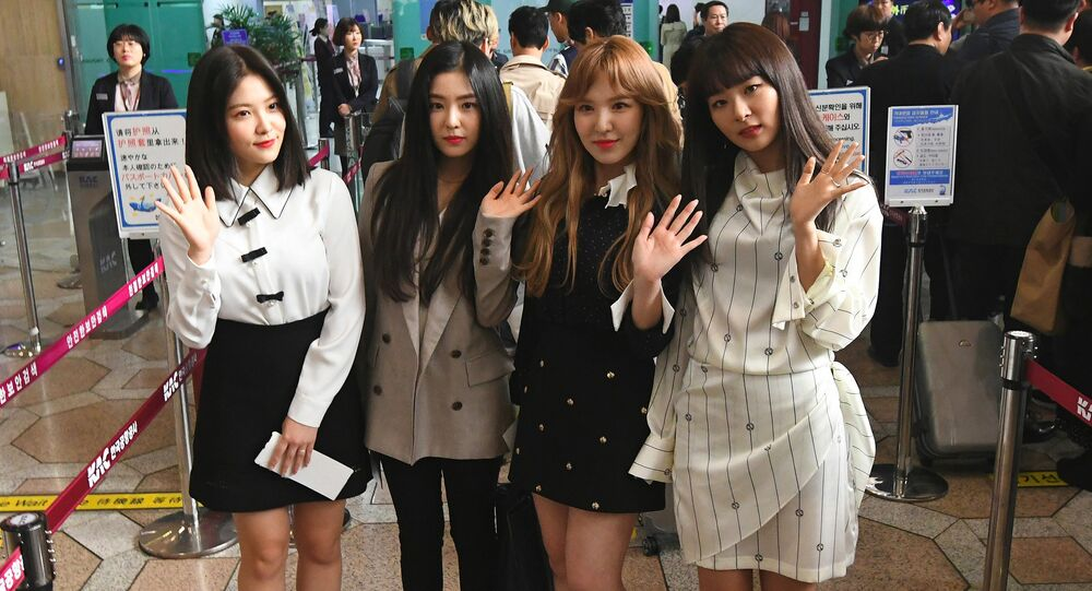 Members of K-pop girlband Red Velvet pose for a photo before departing for Pyongyang from Gimpo International Airport in Seoul