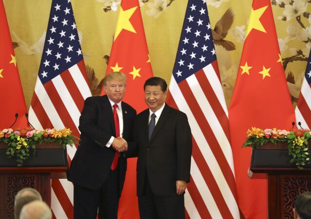 US President Donald Trump and Chinese President Xi Jinping shakes hands during a joint press conference at the Great Hall of the Peopleb in Beijing. File photo