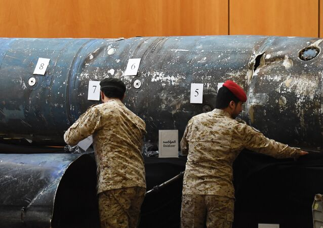 Saudi soldiers reveal the remains of missiles, that a military coalition led by Saudi Arabia claim are Iranian during a press conference at the Armed Forces club in Riyadh on March 26, 2018