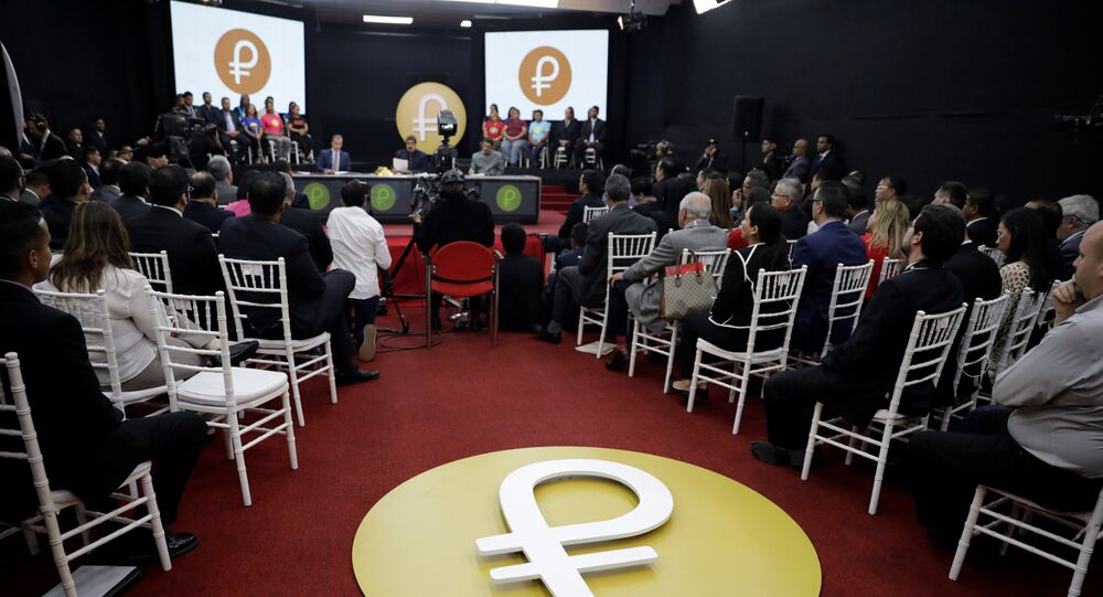 The Venezuelan cryptocurrency Petro logo is seen as Venezuela's President Nicolas Maduro speaks during a meeting with the ministers responsible for the economic sector at Miraflores Palace in Caracas, Venezuela March 22, 2018