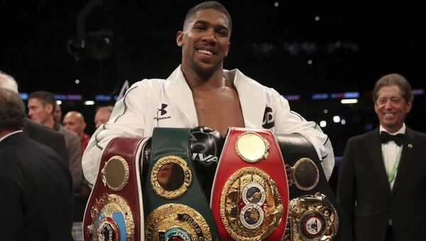 Anthony Joshua holds the WBA, IBF and WBO belts after beating Joseph Parker in Cardiff - Sputnik International