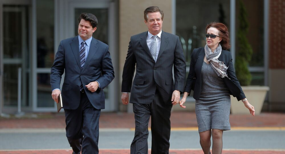 Paul Manafort (C), former campaign manager for U.S. President Donald Trump, arrives with his wife Kathleen (R), for an arraignment at the federal courthouse in Alexandria, Virginia, U.S., March 8, 2018