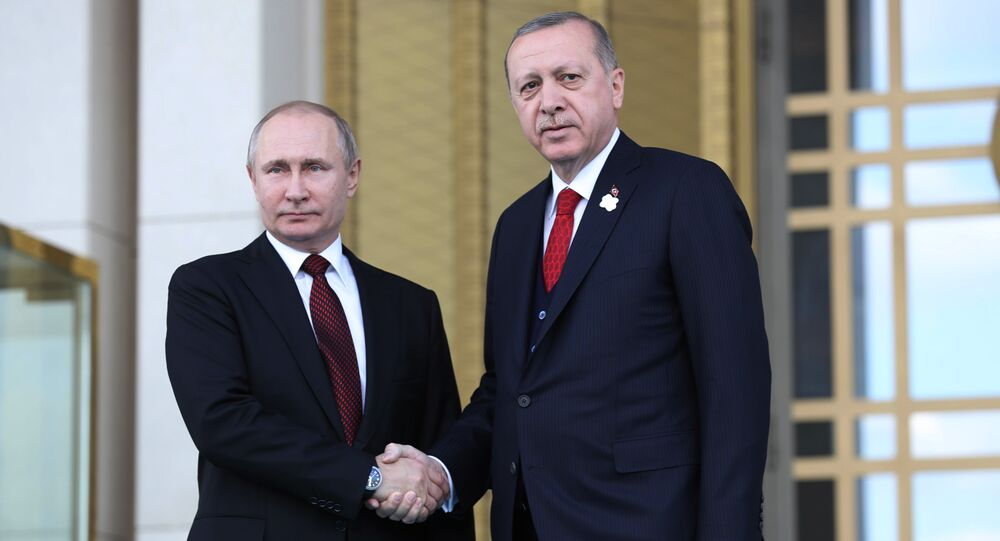 Turkish President Tayyip Erdogan shakes hands with his Russian counterpart Vladimir Putin during a welcoming ceremony at the Presidential Palace in Ankara on April 3, 2018