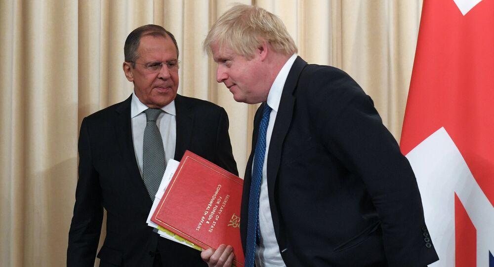 Russian Foreign Minister Sergei Lavrov and British Foreign Secretary Boris Johnson