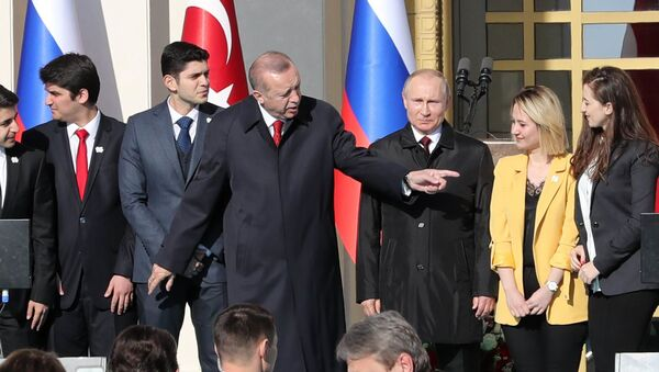 Turkish President Tayyip Erdogan (3rdL) and his Russian counterpart Vladimir Putin (3rdR) attend a symbolic ground-breaking ceremony for Turkey's first nuclear power station at the Presidential Palace in Ankara on April 3, 2018 - Sputnik International