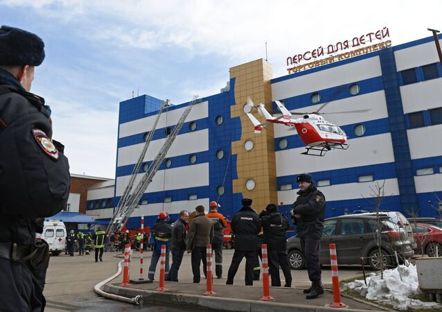 An air ambulance helicopter outside the Persei shopping mall in Moscow where a fire broke out