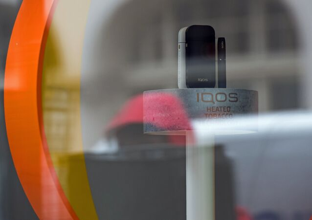 Heatless tobacco units are pictured in the widow display of an iQOS smokeless cigarette store on Wardour Street in London on May 9, 2017