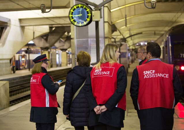 Employees of the SNCF state railway company on the platform of the Montparnasse station in Paris.