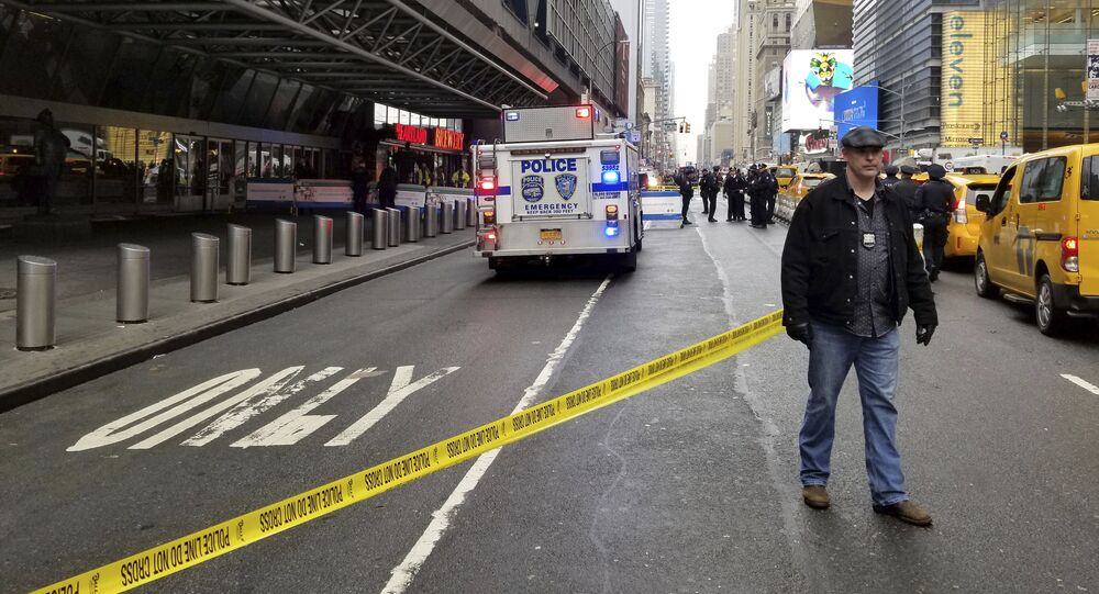 Police outside of New York's Port Authority bus terminal prevent people from entering after a report that an unidentified white powder was found there, Wednesday morning April 4, 2018