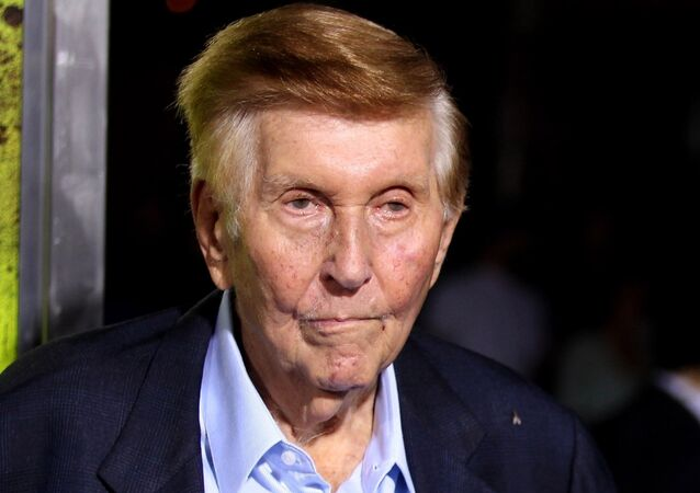 FILE - In this Oct. 1, 2012, file photo, Sumner Redstone attends the premiere of Seven Psychopaths in Los Angeles. On Thursday, Sept. 29, 2016, Redstone's firm, National Amusements, the company that controls CBS and Viacom, announced it wants the two media companies to combine again, more than a decade after they went their separate ways. CBS Corp. produces TV shows and owns its namesake network. Viacom Inc. owns cable channels MTV, Nickelodeon and VH1.