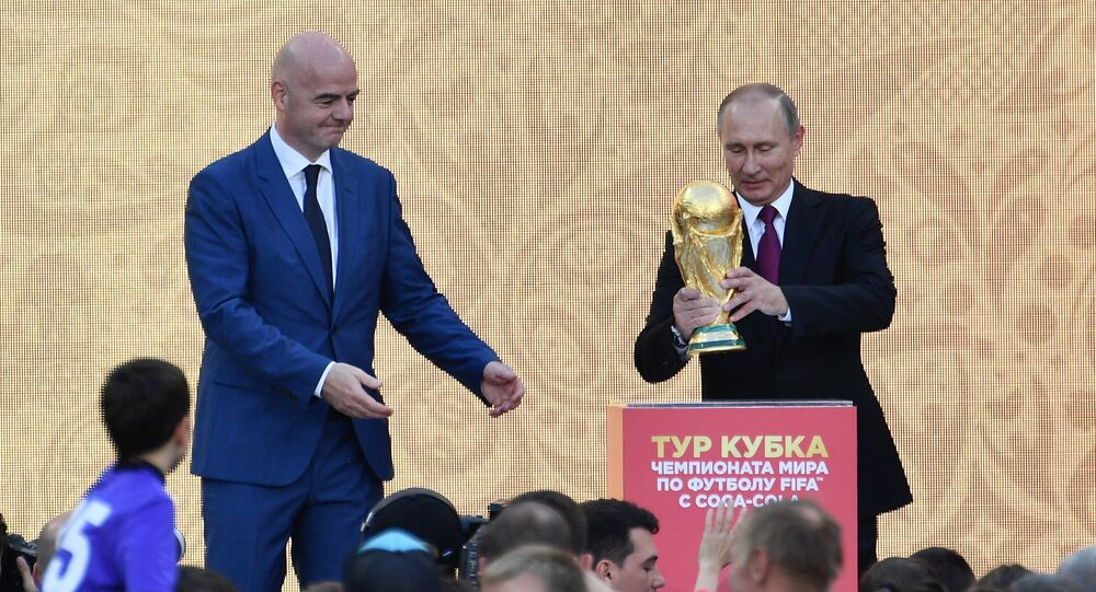 (File) Russian President Vladimir Putin kick starts the FIFA World Cup Trophy Tour at the Grand Sports Arena, which was opened after a reconstruction, during the visit to the Luzhniki Olympic Complex in Moscow. Left: FIFA President Gianni Infantino