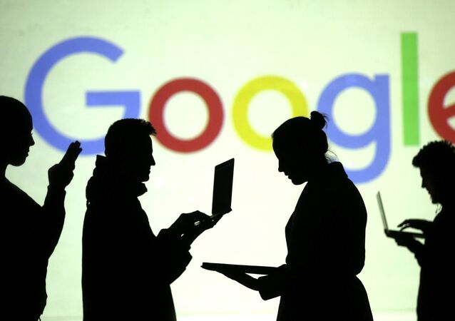 Silhouettes of laptop and mobile device users are seen next to a screen projection of Google logo in this picture illustration taken March 28, 2018