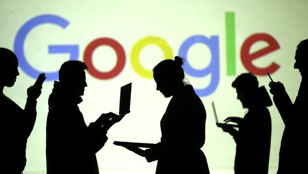 Silhouettes of laptop and mobile device users are seen next to a screen projection of Google logo in this picture illustration taken March 28, 2018 - Sputnik International