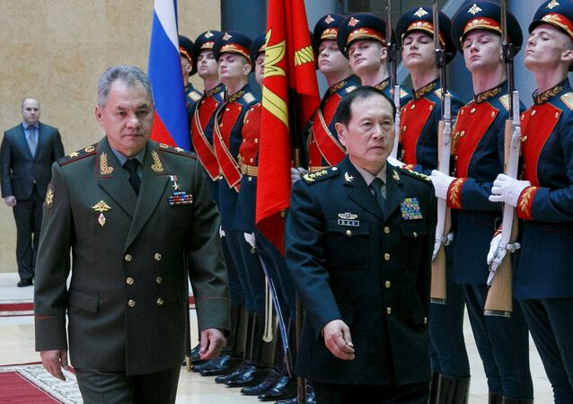 Russian Defense Minister Sergei Shoigu and Chinese Defense Minister Wei Fenghe review a honour guard prior to their talks in Moscow, Russia