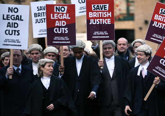 Barristers, dressed in traditional wigs, protesting against legal aid cuts in 2014