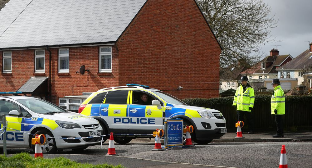 Police officers guard the cordoned off area around the home of former Russian intelligence officer Sergei Skripal in Salisbury, Britain, April 3, 2018