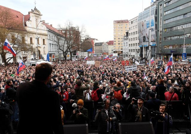 People attend a protest rally in reaction to the murder of Slovak investigative reporter Jan Kuciak and his fiancee Martina Kusnirova, in Bratislava, Slovakia April 5, 2018