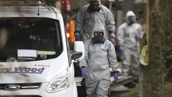 Investigators in protective clothing remove a van from an address in Winterslow, Wiltshire, as part of their investigation into the nerve-agent poisoning of ex-spy Sergei Skripal and his daughter, in England, Monday, March 12, 2018 - Sputnik International