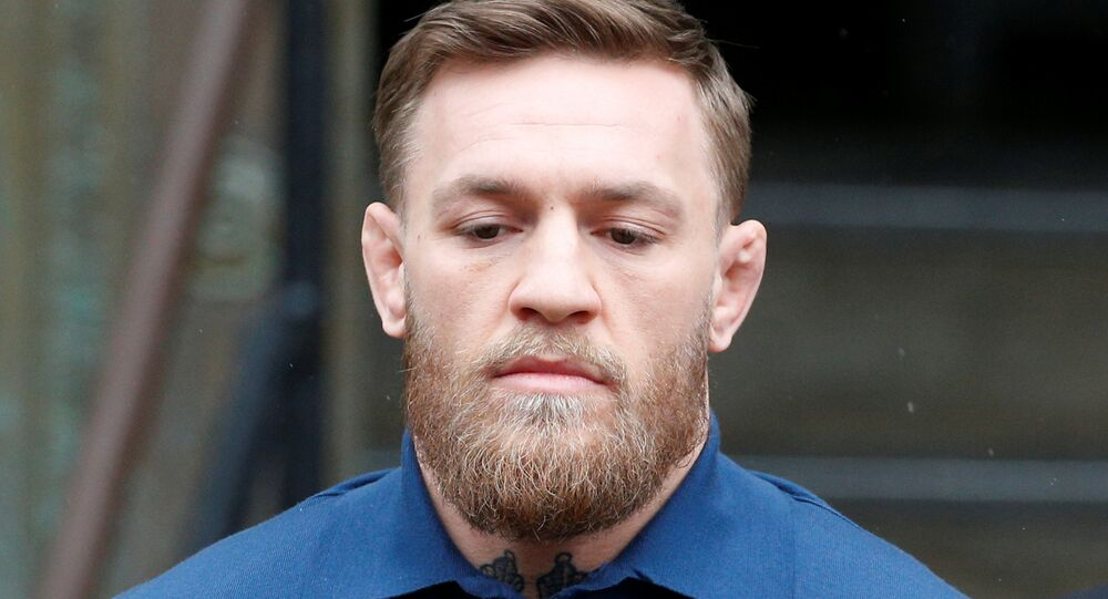 Mixed Martial Arts fighter Conor McGregor is escorted by New York City Police (NYPD) detectives from the 78th police precinct after charges were laid against him in the Brooklyn borough of New York City, U.S., April 6, 2018