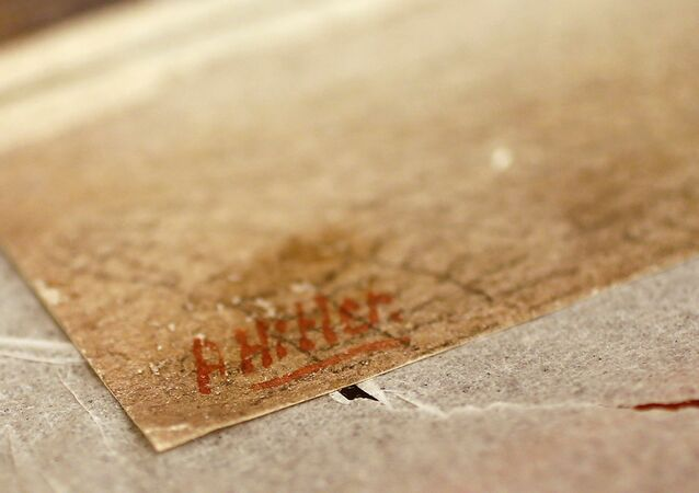 The signature of former German dictator Adolf Hitler is seen on a painting of the old registry office in Munich, at Weidler auction house in Nuremberg November 18, 2014