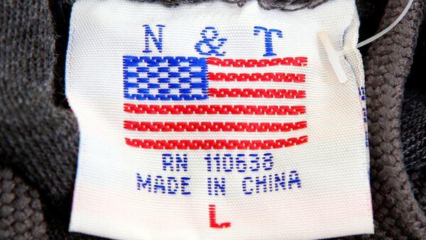 The label of a Washington D.C. sweatshirt bears a U.S. flag but says Made in China at a souvenir stand in Washington, DC, U.S., January 14, 2011 - Sputnik International