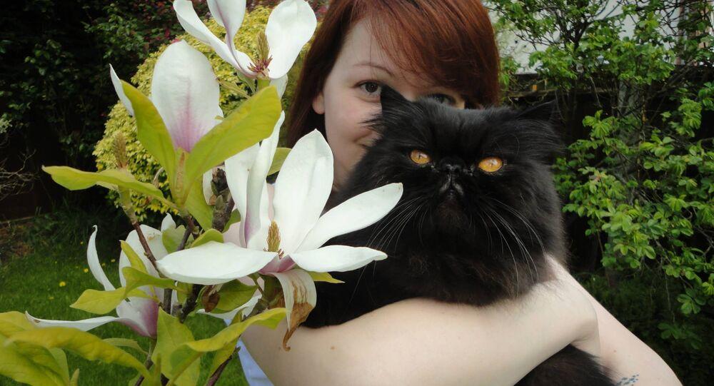 Yulia Skripal poses with a cat. File photo