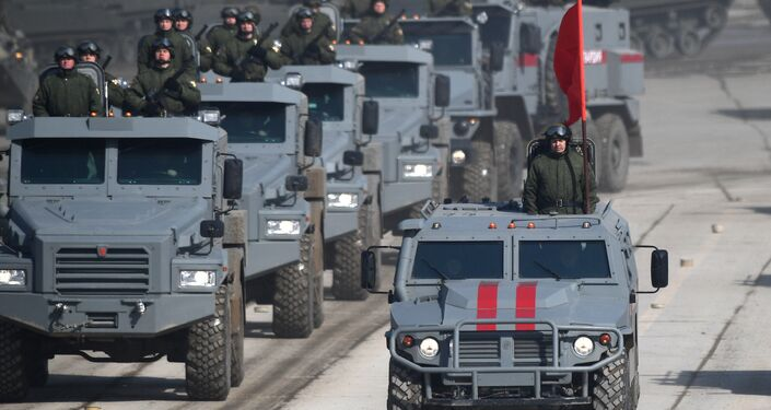 Patrol and Tigr armored vehicles during a Victory Day Military Parade rehearsal at the Alabino military training ground in the Moscow Region