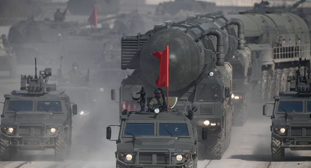 Tigr armored vehicles and a Yars land-based mobile missile system during a Victory Day Military Parade rehearsal at the Alabino military training ground in the Moscow Region