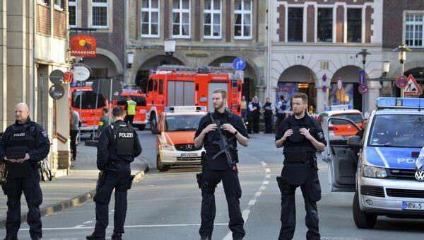 Police officers secure the crime scene after a car crashed into a group of people leaving several dead in Muenster, Germany, Saturday, April 7, 2018. - Sputnik International
