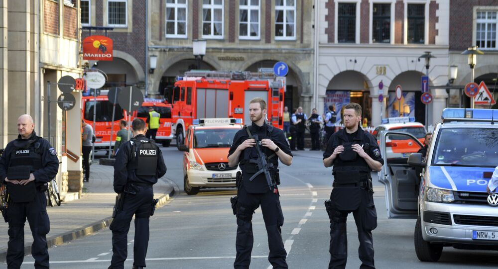 Police officers secure the crime scene after a car crashed into a group of people leaving several dead in Muenster, Germany, Saturday, April 7, 2018.
