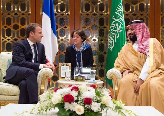 In this Thursday, Nov. 9, 2017, photo released by Saudi Press Agency, SPA, Saudi Crown Prince Mohammed bin Salman, right, meets with French President Emmanuel Macron upon his arrival in Riyadh, Saudi Arabia