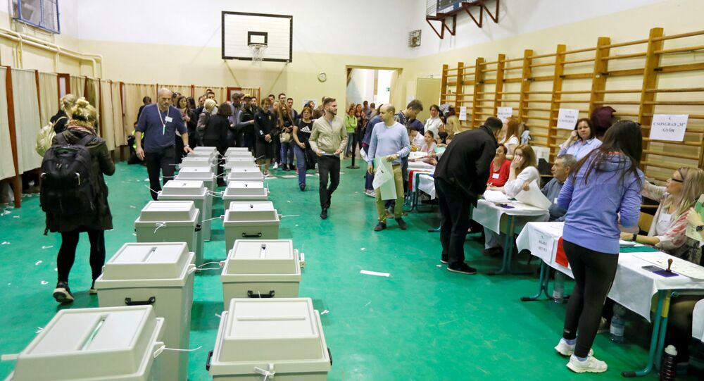 People vote during Hungarian parliamentary election after the official closing of the polling station in Budapest, Hungary, April 8, 2018