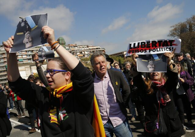 People hold pictures of Spain´s King Felipe VI upside down during a protest called by Catalan pro-independence demonstrators against the visit of the king in Barcelona