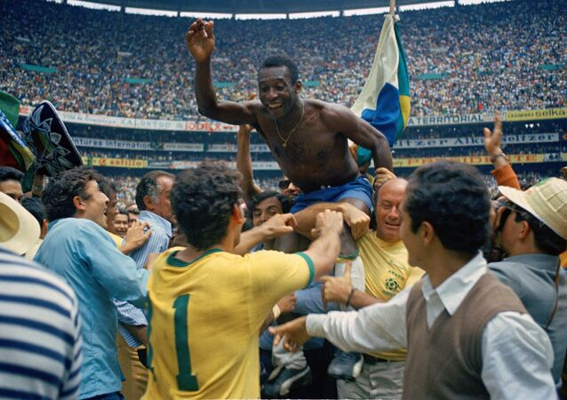 Pele celebrates after Brazil win their third World Cup in Mexico in 1970