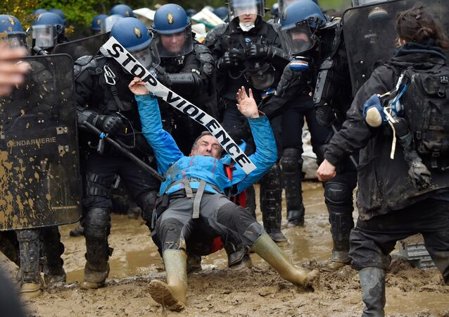 French gendarmes charge ZAD activists to clear an area known as ZAD (Zone a Defendre - Zone to defend) of environmental protesters occupying the site of what had been a proposed new airport in Notre dame des Landes