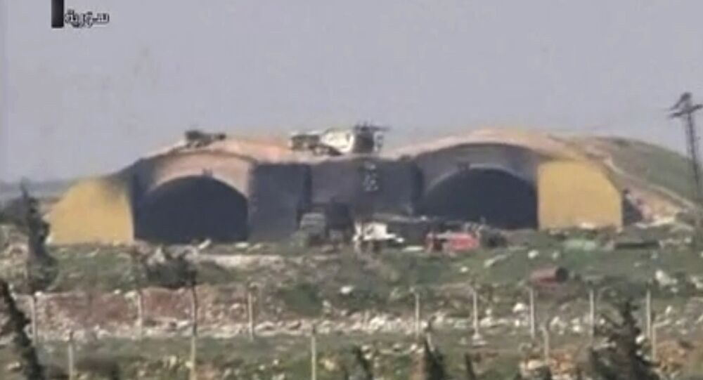This frame grab from video provided by the Syrian official TV, a Syrian government channel that is consistent with independent AP reporting, shows the burned and damaged hangar warplanes which attacked by U.S. Tomahawk missiles, at the Shayrat Syrian government forces airbase, southeast of Homs, Syria, early Friday April, 7, 2017
